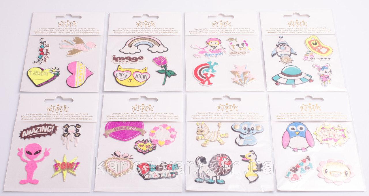 Варианты современных наклеек на покрытие ткани