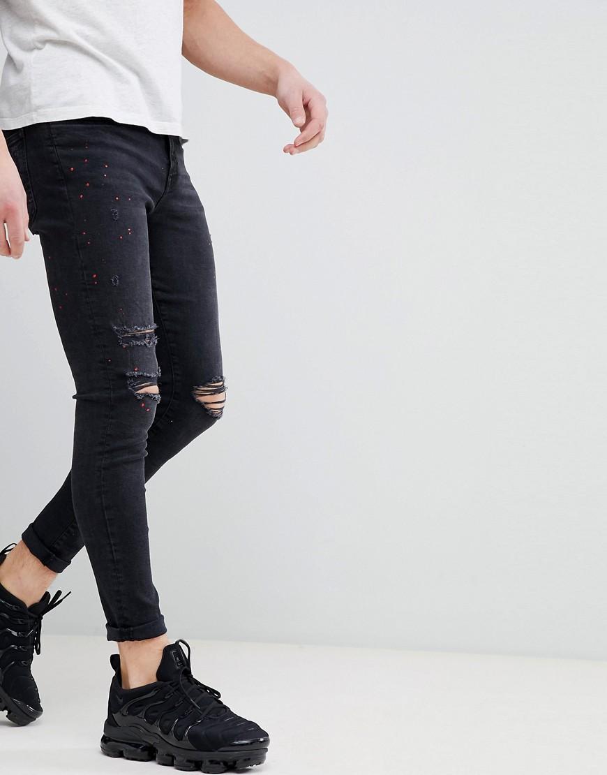 Черные супероблегающие джинсы с дырками на коленях