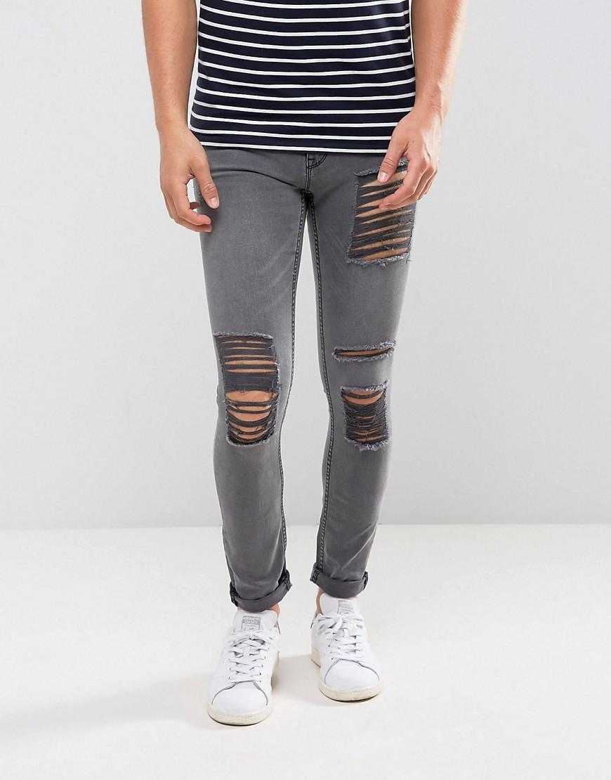 Серые выбеленные джинсы скинни