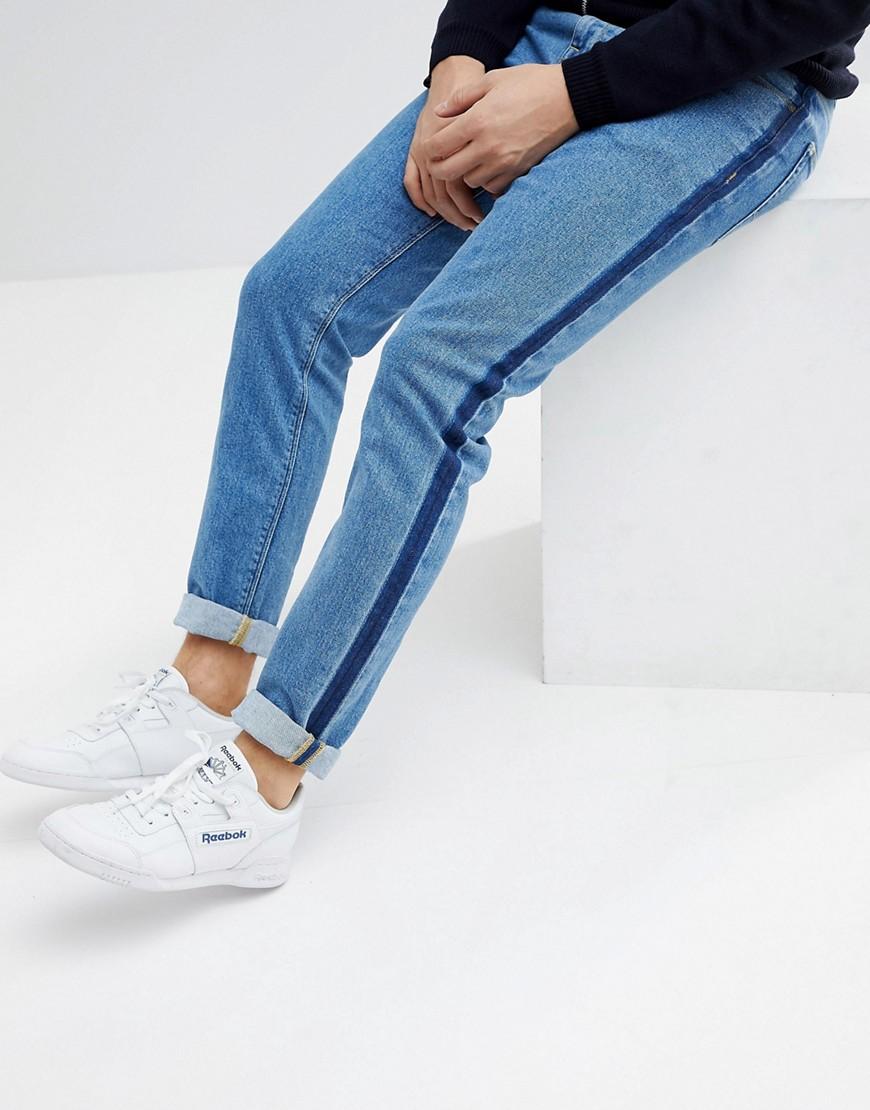 Синие джинсы скинни с полосами