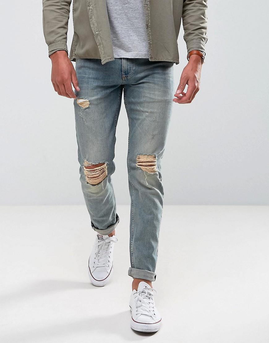 Узкие выбеленные джинсы