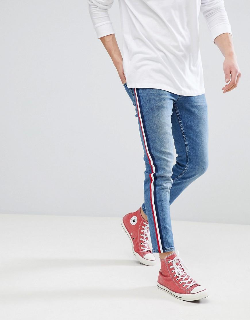 Выбеленные синие узкие джинсы