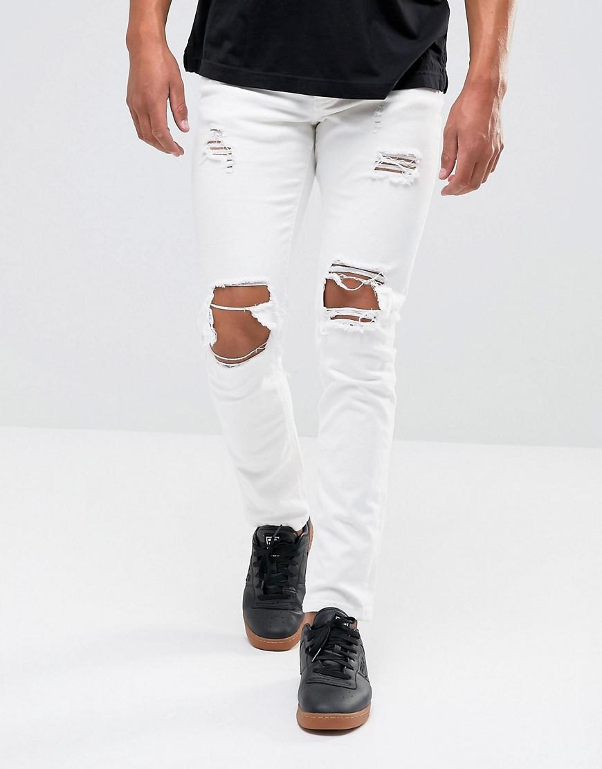 Белые рваные джинсы скинни