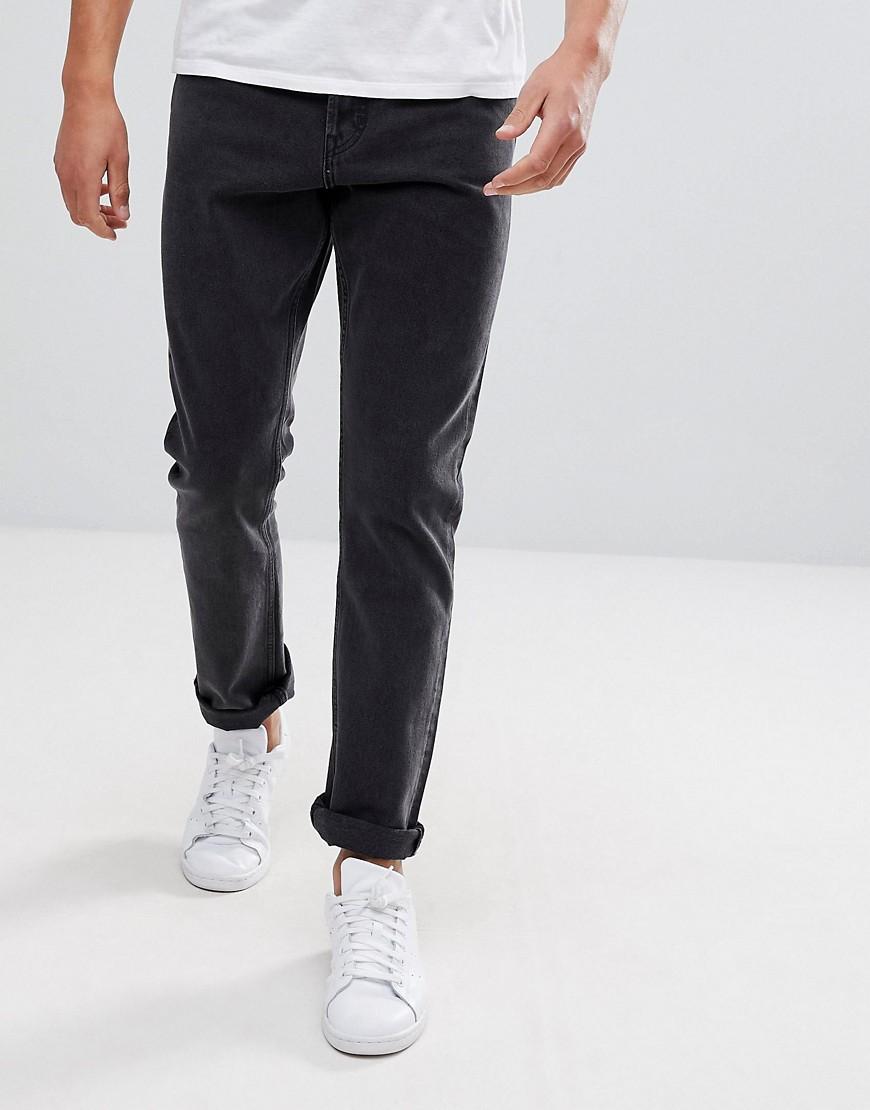 Черные укороченные джинсы слим заниженного кроя