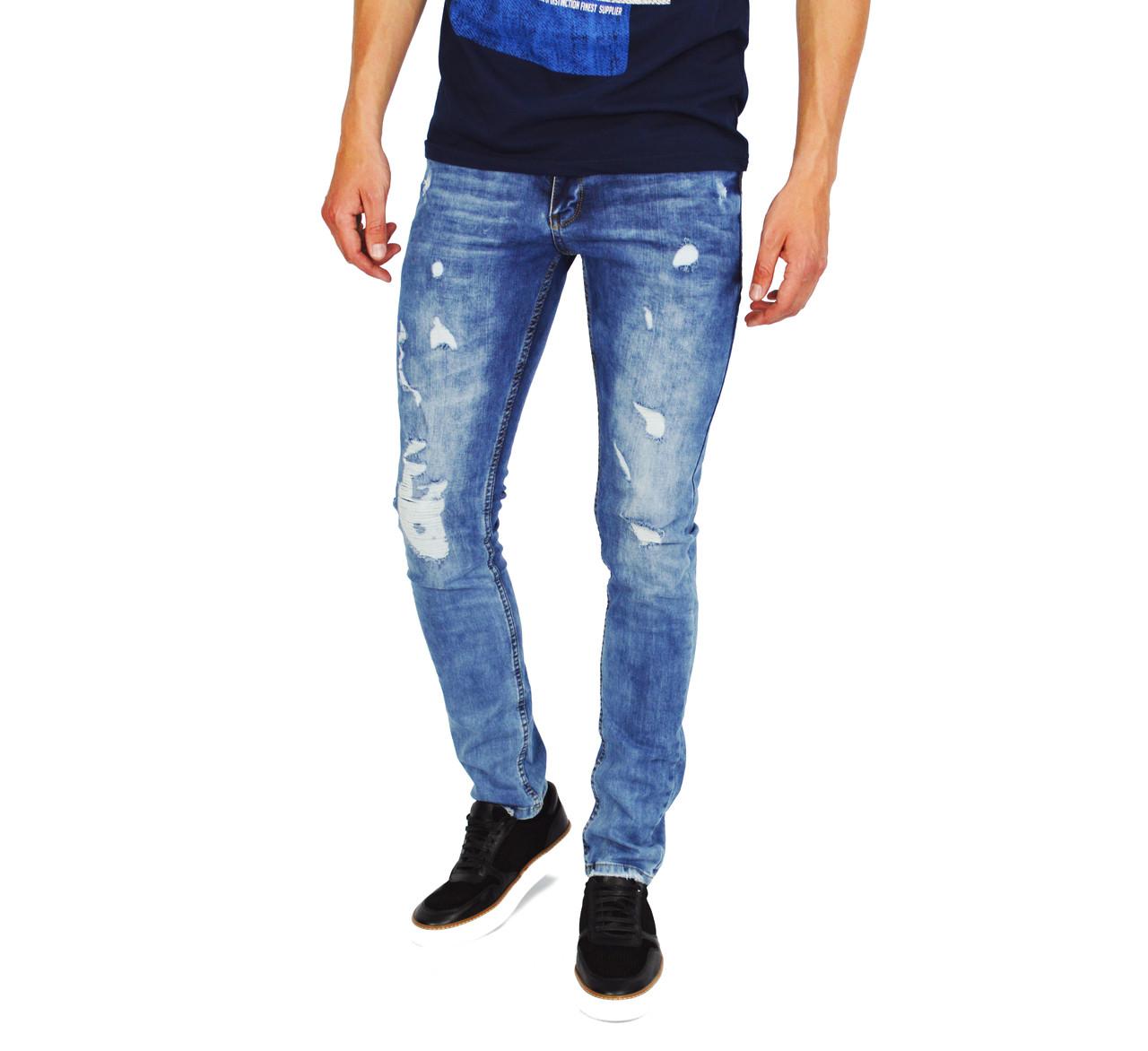 Голубые рваные мужские джинсы зауженные
