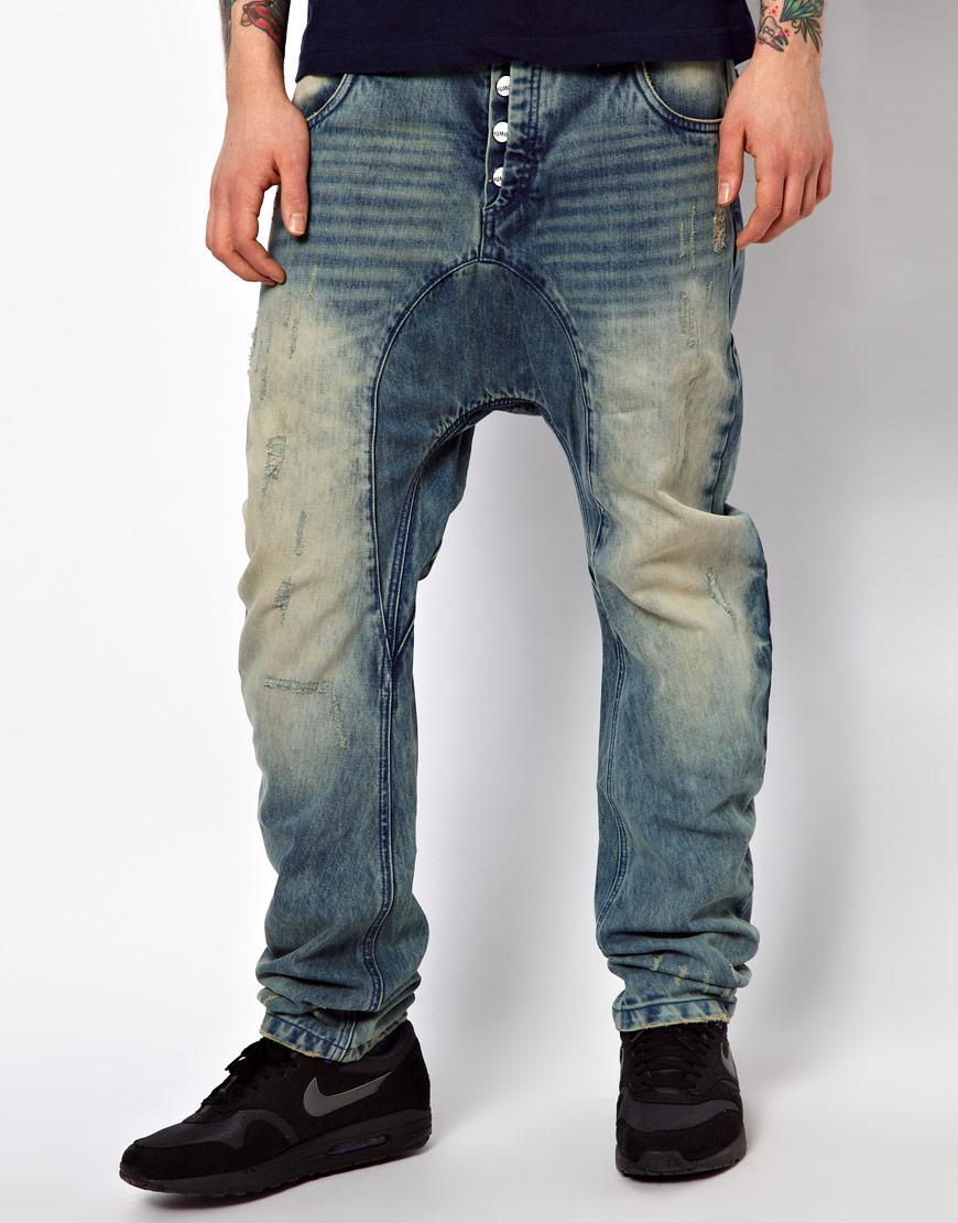 Потертые джинсы галифе