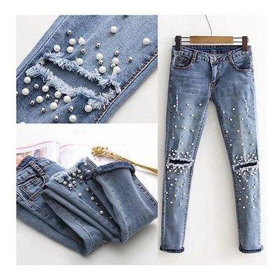 Рваные джинсы с бусинками