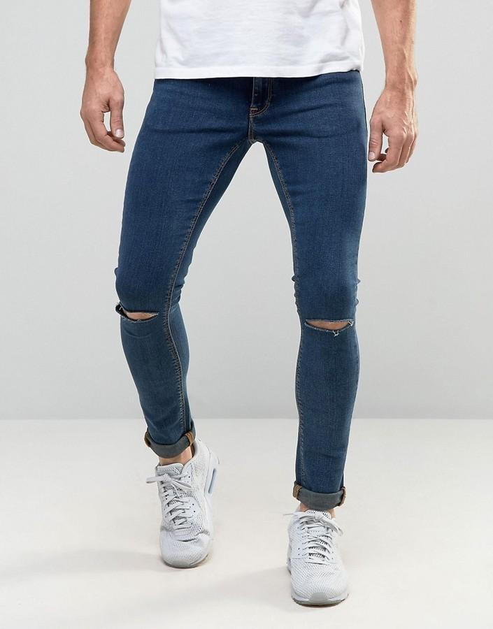 Рваные темно-синие штаны