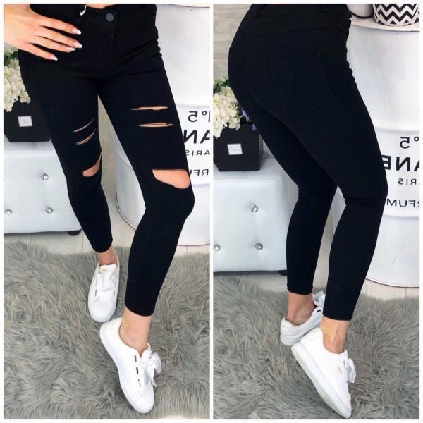 Прорези на черных джинсах
